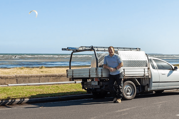 Nick Rice and Plumbing Ute by the sea