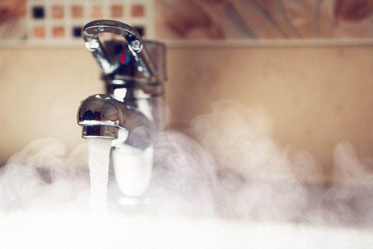 Running chrome tap with steam showing hot water