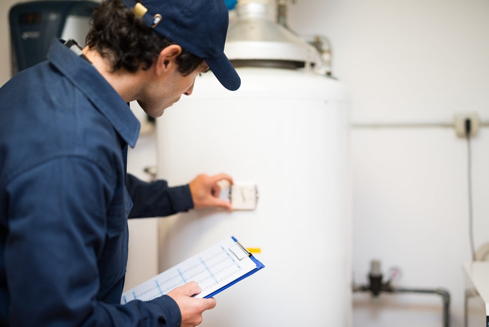 Plumber checking a water heater