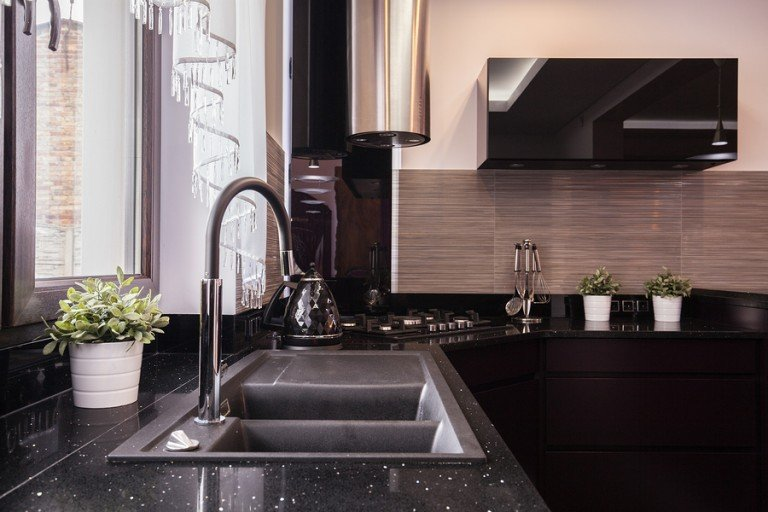 Modern kitchen with stone benchtop and stainless steel fittings
