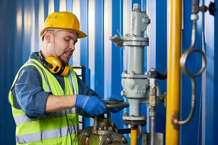 Commercial Plumber working on gas pipes
