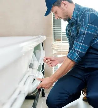 Plumber installing pipes and lines