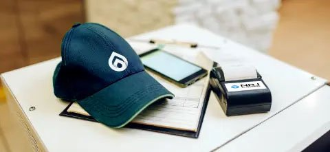 Cap phone, diary and ETFPOS machine on table