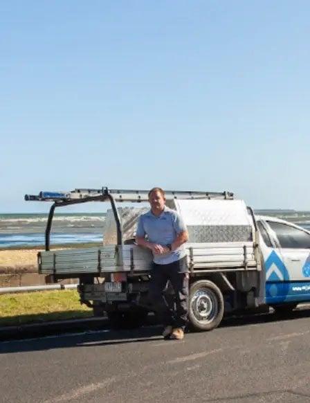 Nick Rice leaning against NRJ branded Ute- Plumber renovations Frankston and Mornington Peninsula
