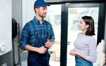 plumber talking to women