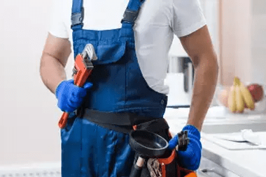 Plumber with tools and tool belt